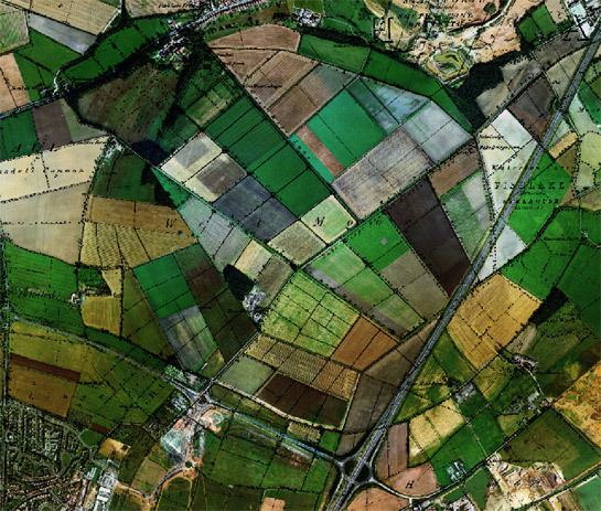 Figure 4: The circular outline of the pre-drainage 'West Moor' is still perceptible in boundary patterns shown on this 1999 aerial image (overlain with 1854 OS 6 inch to the mile data)